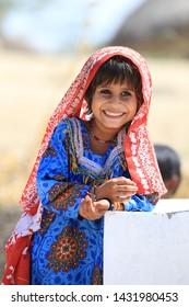 Tharparkar Sindh, Pakistan - March, 2019: Poor Village Girl Boys Children Smiling Shying Face Closeup in Traditional Dress Thar Desert and Rajhastan India, Hinduism in Pakistan Hindu Religion People