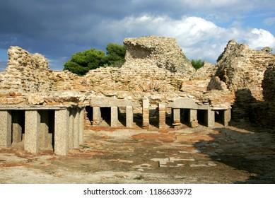Tharros, Sardinia 22.08.2008 Phoenician/Roman ruins at Tharros once an ancient city on the west coast of Sardinia. Tetrastyle Temple and stone mosaic