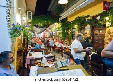 THASSOS, GREECE - SEPTEMBER 05 2016 - Outdoor taverns by night on Thassos Island, Greece