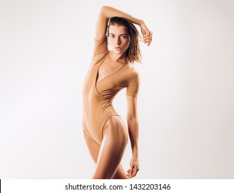 That bodysuit is very slimming. Sexy fitness model look fit and slim. Slimming diet and dieting for ideal body weight and shape. Body slimming gel or scrub. Slimming, beauty and a healthy lifestyle.