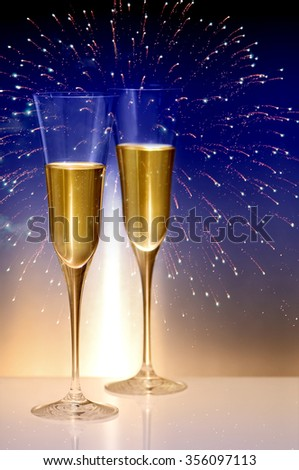 that calls for a drink happy new year two glasses of champagne against midnight