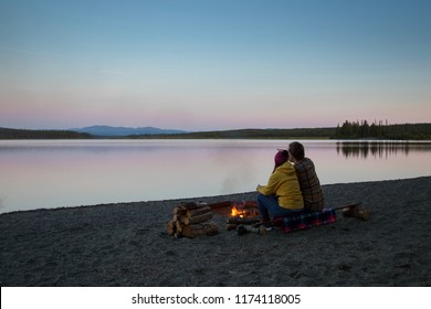 That camping mood what you need to have in the middle of Yukon, Canada, Morley Lake, Young traveling couple