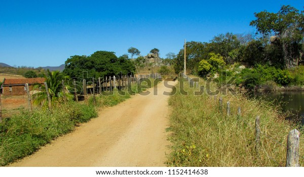 That classic road that takes you not where, but beautiful landscape with orange land, next to a pond, and a beach