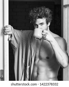 That was great night. Guy attractive lover enjoy morning coffee. Seductive lover full of desire. Macho tousled hair coming out bedroom door. Man lover near door. Sexy bachelor lover concept.