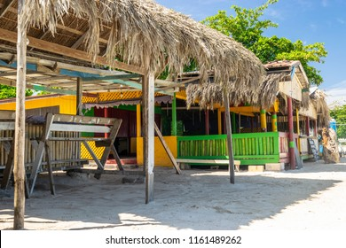 Thatch roof shops along the Seven Mile Beach in Negril, Jamaica