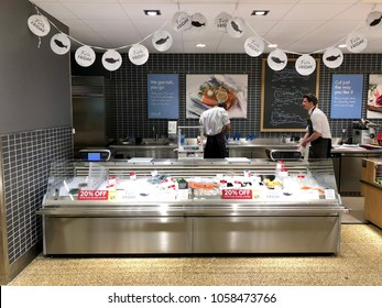 THATCHAM, BERKSHIRE - MARCH 31, 2018: Fish monger counter at Waitrose supermarket in Thatcham, Berkshire, UK.