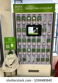 THATCHAM, BERKSHIRE - MARCH 31, 2018: Scan as you shop barcode scanning technology handset docking station at Waitrose supermarket in Thatcham, Berkshire, UK.