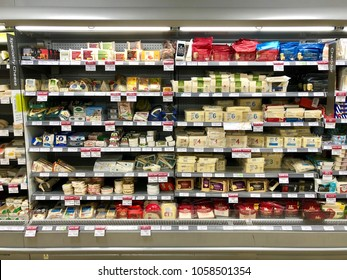 THATCHAM, BERKSHIRE - MARCH 31, 2018: Cheese and dairy products on sale in the refrigerated section at Waitrose supermarket in Thatcham, Berkshire, UK.
