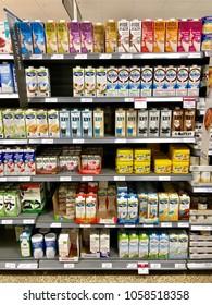 THATCHAM, BERKSHIRE- MARCH 31, 2018: Dairy free milk cartons on sale at Waitrose in Thatcham, Berkshire, UK.
