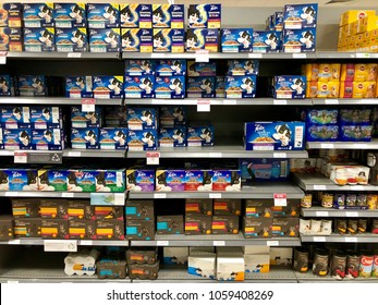THATCHAM, BERKSHIRE - MARCH 31, 2018: Cat and fog food stocked on shelves in the aisles of Waitrose supermarket in Thatcham, Berkshire, UK.