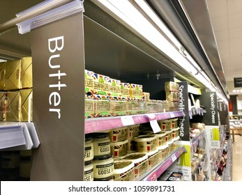 THATCHAM, BERKSHIRE - MARCH 31, 2018: Butter, dairy and fat products in the chilled refrigerator section of Waitrose supermarket in Thatcham, Berkshire, UK.