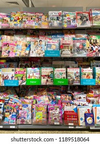THATCHAM, UK - SEPTEMBER 23, 2018: Magazines and print media on sale at Waitrose & Partners supermarket in Thatcham, Berkshire, UK.