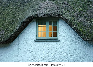 Thatched cottage roof and window in the Cornish countryside, Cornwall, UK