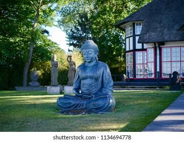 Thatched Mikado Garden with Buddhastaue, Timmendorfer beach, Ostholstein, Schleswig-Holstein, Germany, Europe