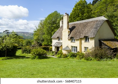 Thatched roof cottage in a typical English village with scenic views of Exmoor national park. Copy space for text.