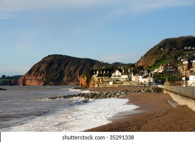 Thatched roofed houses beside the  beach and sea wall in Sidmouth, England