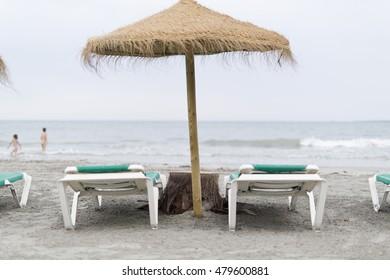 Thatched umbrellas on a beach in Santa Pola, Spain