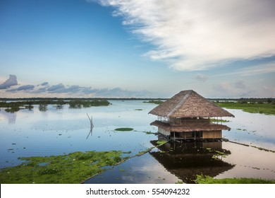 A thatched-roof hut on the shallow banks of the Amazon River near Iquitos, Peru.