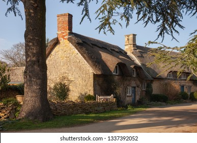Thathced cottage at Hidcote Bartrim, Cotswolds, Gloucestershire, England