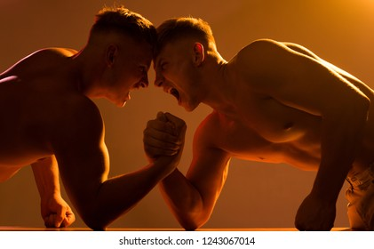 Thats our strength. Twins men competing till victory. Twins competitors arm wrestling. Men competitors try to win victory or revenge. Revenge in sport. Strength skills.