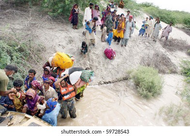 THATTA, PAKISTAN - AUG 22: Navy officials evacuate flood affected people with the help of hovercraft at Behram Keti on August 22, 2010 in the Thatta District. (Aftab Ahmed /PPI Images)