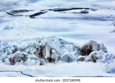Thawed hummock of coastal ice. The North pole at latitude 98 degrees north