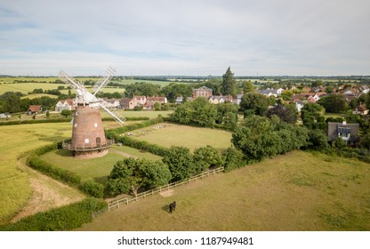 THAXTED, UK - 23 JUNE 2018: An aerial view of the village of Thaxton in the heart of Essex, England with its landmark traditional old English windmill.