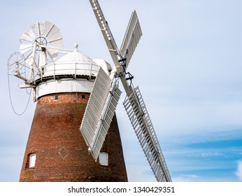 THAXTED, UK - 23 JUNE 2018: A traditional old English windmill near the Essex village of Thaxted set against a blue summer sky.
