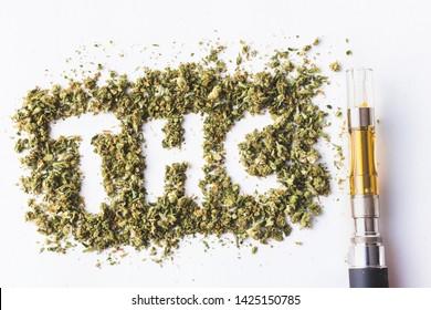 THC Acronym In Marijuana Shake With Marijuana Extract Oil Vape Pen On White Background
