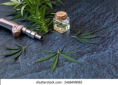 THC Oil Extract in Cartridge Close-up of Vaping Cannabis Isolated on Dark Background with Smoke