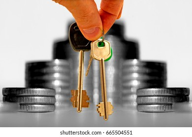 The keys to the apartment on a background of money . The concept of mortgage lending .