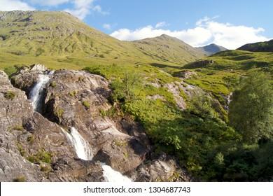 """The Meeting of the Three Waters"" Waterfall in Glen Coe, Scotland"