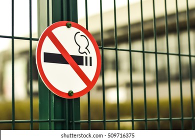 """The sign on the metal fence """" no Smoking """""""