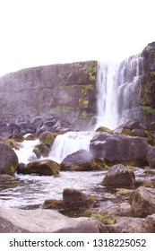Öxaráfoss (The waterfall in the Ax River) in the ravine Almannagjá at Þingvellir