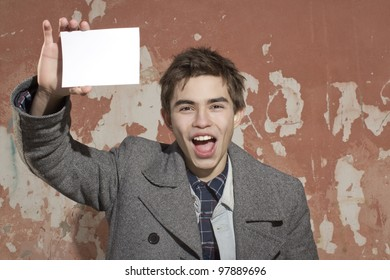 The young man holds a pure sheet of paper