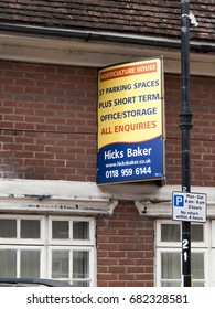 Theale, High Street, Berkshire, England - June 30, 2017: Hicks Baker estate agent board above vacant property, office and storage space