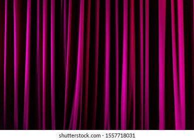 The theater curtains are closed.