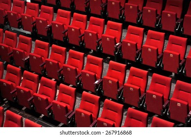 Theater with empty red seats