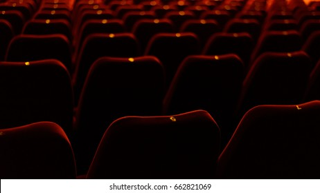 theater interior with red seat and number