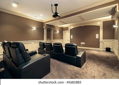Theater in luxury home with stadium seating