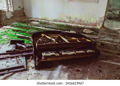 Theater piano in destroyed abandoned ghost city Pripyat ruins after Chernobyl disaster. Chernobyl Nuclear Power Plant atomic reactor explosion. Exclusion zone, radiation risk, fallout lost town.