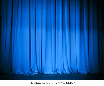theater stage blue curtain