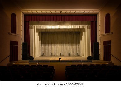 Theater stage and curtain illuminated by stage light.