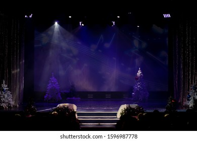 A theater stage with a curtain illuminated by stage light and smoke. Texture background for design.