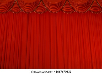 Theater stage red curtains or cinema drapes.