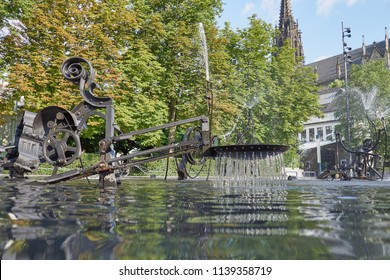 THEATERSTRASSE, BASEL, SWITZERLAND - JUNE 2018: Closeup of the famous kinetic Jean Tinguely fountain in Basel ('Fasnachts-Brunnen' or 'Carnaval Fountain') - Basel was Tinguely's home town.