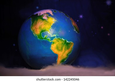 theatre backdrop featuring the earth in space