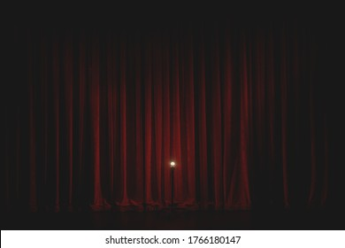 The Theatre Curtain Goes Up