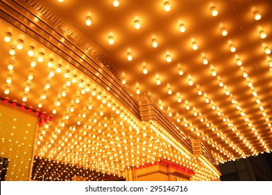 Theatre Marquee Lights - Picture of rows of theater marquee lights on the ceiling of an old theater entrance