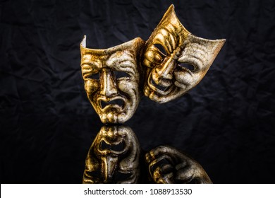 theatrical masks are kind and evil on a black background